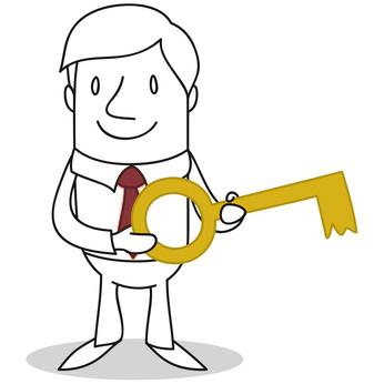Geschäftsmann mit goldenem Schlüssel in den Händen